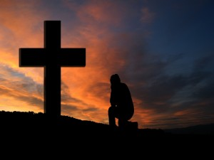 Kneeling at the cross